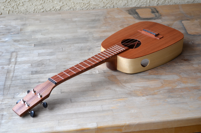Ukulele Hashi has a soundport to help the player hear her in a group.